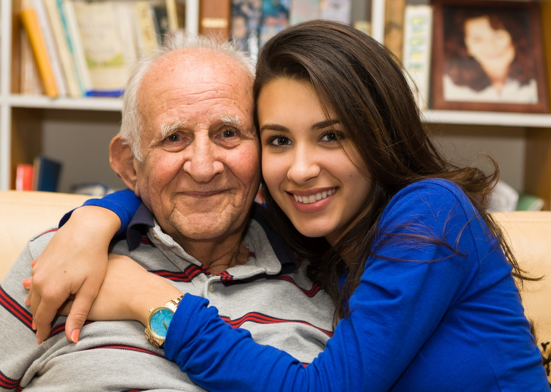 elderly old man with granddaughter in a home setting