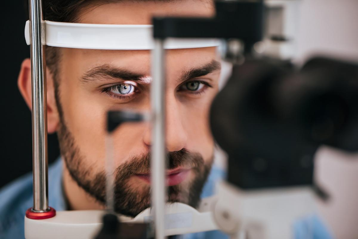 man is checking the eye vision in modern ophthalmology clinic